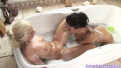 Lesbians taking pleasure in the bathtub